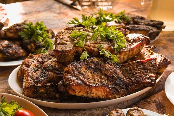 plates of steaks on a table