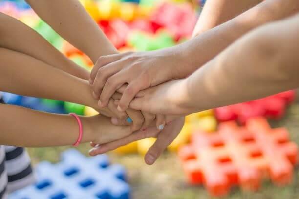 hands held together for support