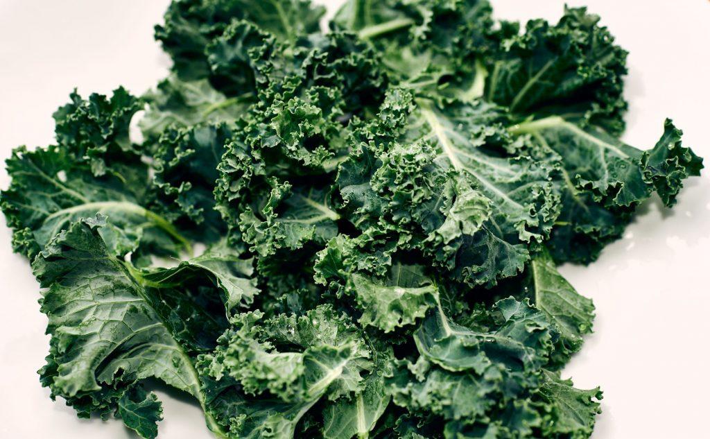 fresh kale on white surface